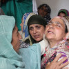 Wailing relatives of the slain Gulzar Ahmad…