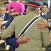 Sidhu hugs Pak Army chief, sits next to PaK prez