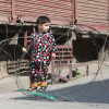 A child looks are concertina wires, laid down by Police, in a Srinagar area…
