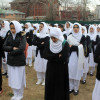 School children hold morning prayers