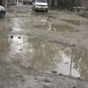 Potholes and inundation makes Budgam-Bemina road inaccessible