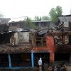 As the operation was called off, locals rushed to the gutted house…