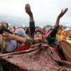 Devotees raise their hands in prayers at Dargah Hazratbal…