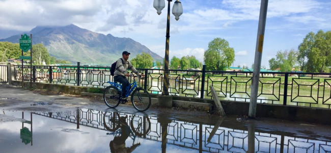 A cyclist is seen peddling on Residency Road side of Jehlum Band on Tuesday.....
