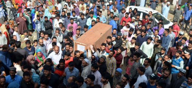 Body of one of the slain cops being carried by locals for last rites.
