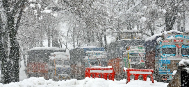 Trucks stranded on Jammu-Srinagar highway during the day as the fresh snow lashes the areas...