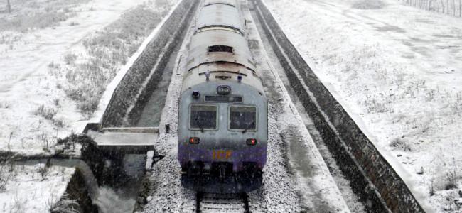 Train chugs through snow-clad tracks as several areas in south Kashmir ...