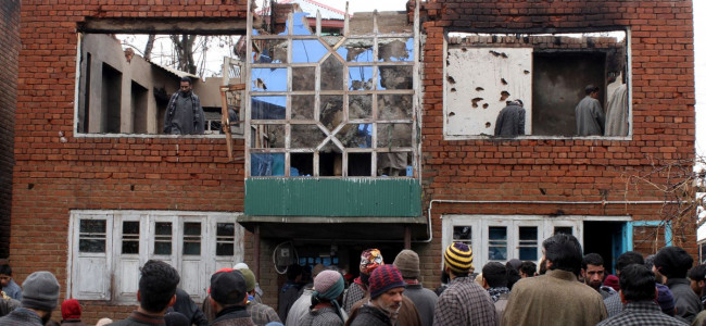 People assemble to look at the remains of the house where ...